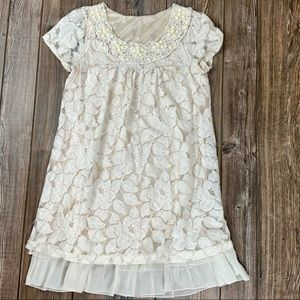Lace lay over cream dress, beaded neckline